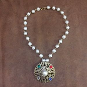 Faux pearl necklace with charm