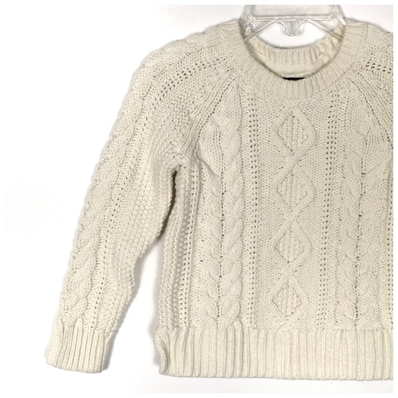 This version of our iconic cable-knit sweater is made from medium-weight combed cotton and washed for added softness. % cotton. Machine washable. Size 4/4T has a 16½