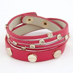 Jewelry - NWOT Pink arm wrap band bracelet with gold studs