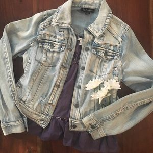 Light wash denim jacket with distressing