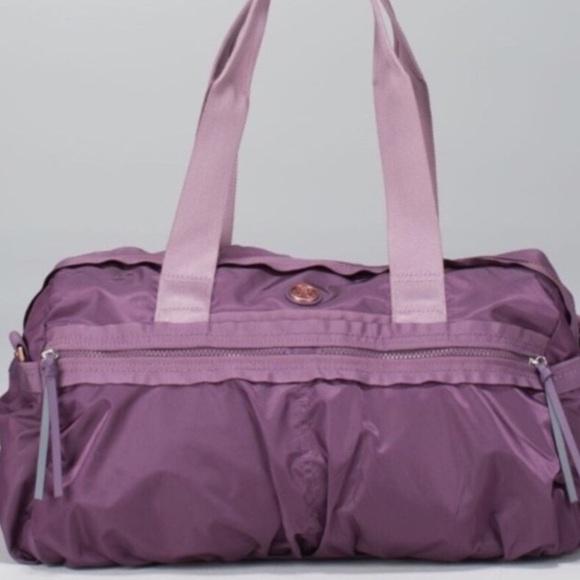 e2ff9a0707f lululemon athletica Handbags - Lululemon gym to win duffle bag (purple)