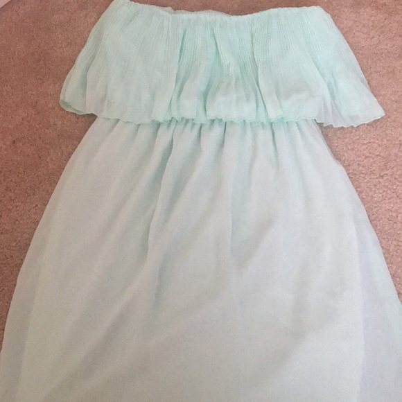 For homecoming, try a two-piece jade green beaded dress or a strapless mint green party dress. For an elegant affair, go with a formal green gown from the variety of teal or emerald green dresses .