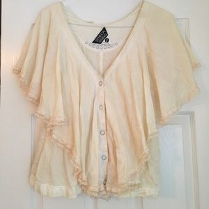 Pale pink flowy top with lace accents