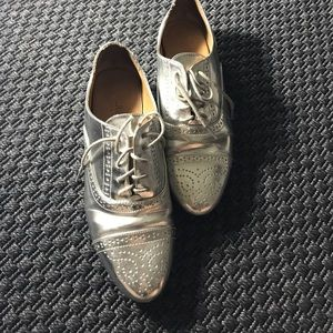 Shiny silver brogues