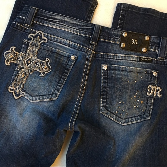 Product Description pair of mid-rise boot cut miss me jeans styled with embroidery on.