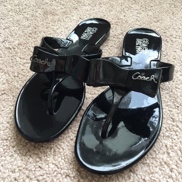 ba5fc523d Coach Shoes - Black Coach Jelly Flip Flops With Bows