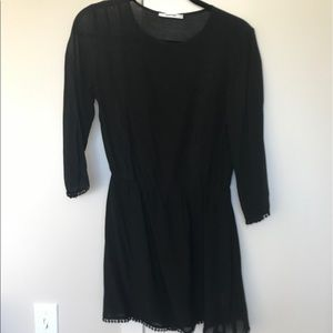 Bohemian-rock style black dress with lace inserts