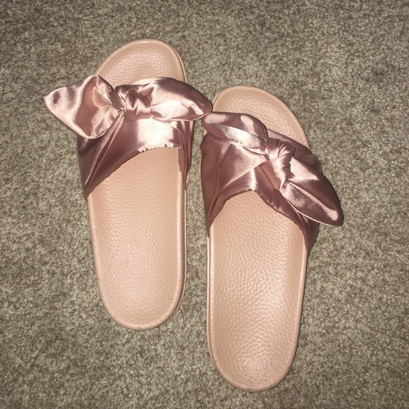 df5d33490254 Pink Bow Tie Slides (imitation of Fenty slides).  M 59639cc8eaf030fd9c0be1a2. Other Shoes you may like. Puma sandals