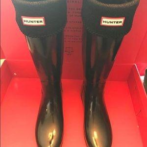 Glossy Black Hunter Boots.