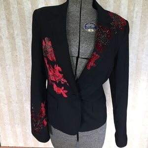 Reba blazer with flower appliqués.