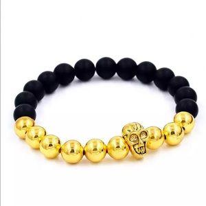 Jewelry - 5/$25 gold skull head bracelet black beads