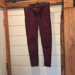 Eggplant color tinsel skinny jeans gently used