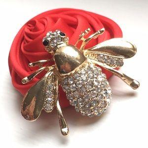 Gold bee brooch
