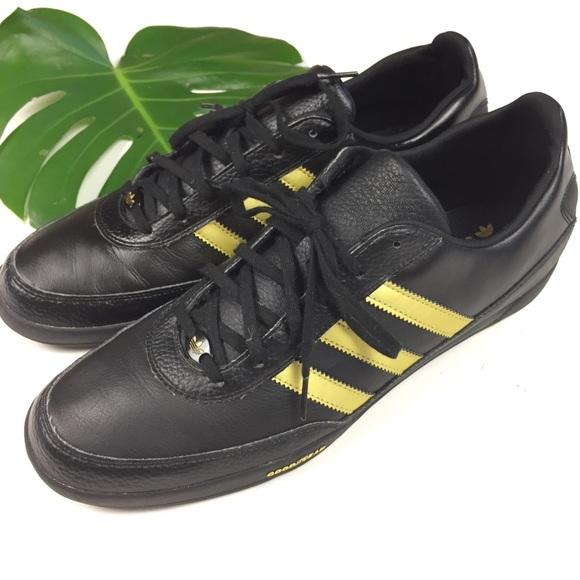 ADIDAS // mens 12.5 black LEATHER gold stripes