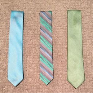 Assorted men's green and blue ties
