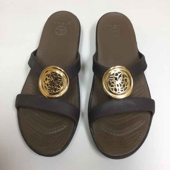 bec80dd0d420 CROCS Shoes - Gold and Brown Medallion Crocs Sandals