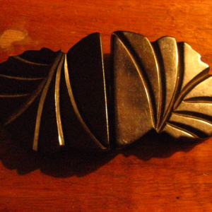 PERFECT condition carved bakelite buckles
