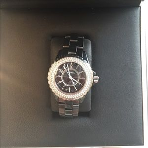 Black Chanel Watch With Silver Face And Diamonds