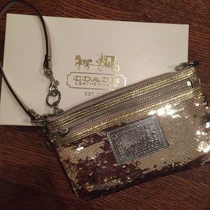 BRAND NEW Gold sequin COACH wristlet. PRICE DROP
