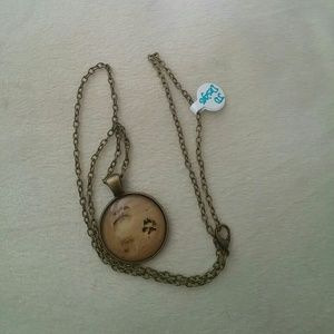 Other - Antique gold Foot print necklace