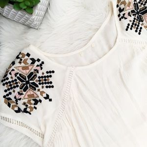 Beautiful cream top w/ embroidery shoulder detail