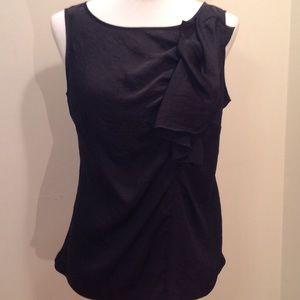 Flowy sleeveless blouse with ruffle