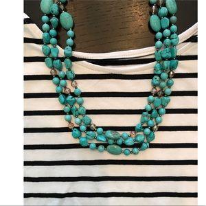 Blue stone necklace.