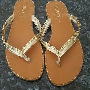 Guess gold flip flops size 8