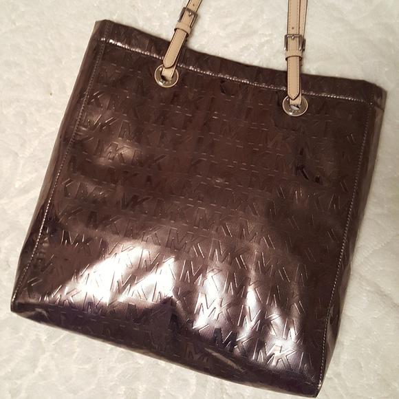 60955b99a6fc43 Michael kors gunmetal purse bag. M_596ac3fc36d594afdf049d78