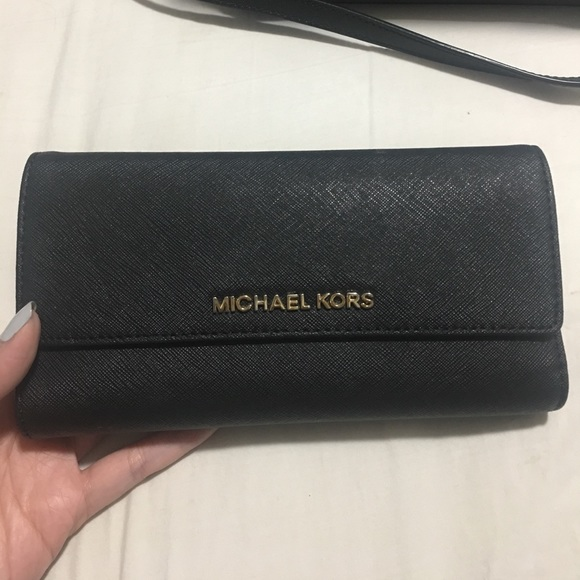 94f1fcec7673 Michael Kors Mercer tri-fold leather wallet. M_596b576db4188edc5c000033