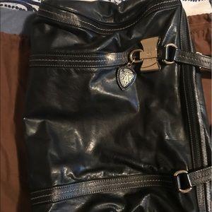 Black Gucci bag.
