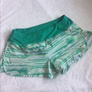 green nike dri-fit shorts size L