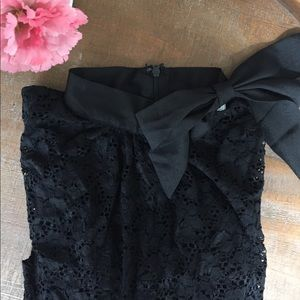 High-neck lace black blouse with bow detail
