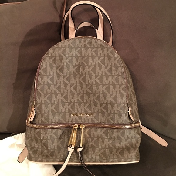 640f809c9e Michael Kors Rhea Zip Medium Mocha Backpack. M 596d4a25f739bc971a00f295
