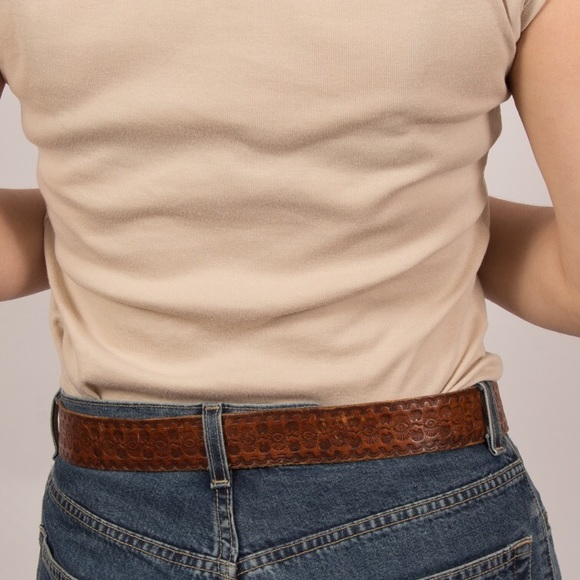 Measuring an existing belt or going by women's pants size will not work the same as it does for men, because women's belts (and pants) are not sized according to waist measurement. For example, a woman with a inch waist will wear approximately size 10 pants - not size