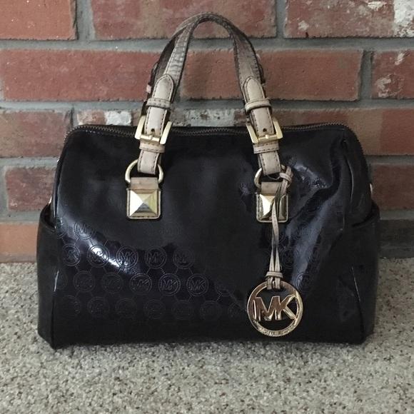 MK black Greyson patent leather. M 596e4c629c6fcf67bc02541b a665a7d04a92f