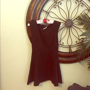 Black mini FP dress.  Form fitting high neck.