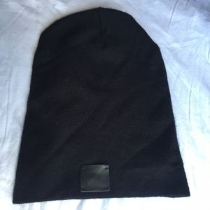 Black beanie with leather patch