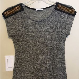 Tops - Black and grey top with studded shoulders.
