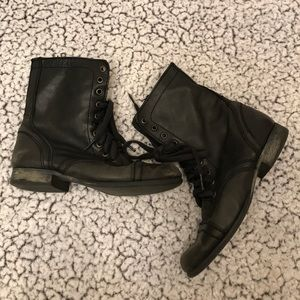 Distressed lace up boots