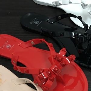 083762b6c750e6 Dizzy Shoes - Red jelly studded bow flip flop