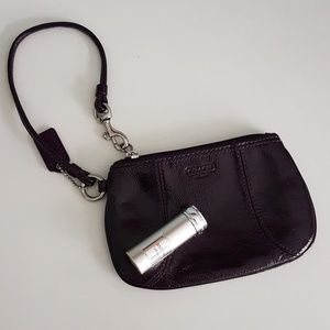 Coach patent  leather purple wristlet