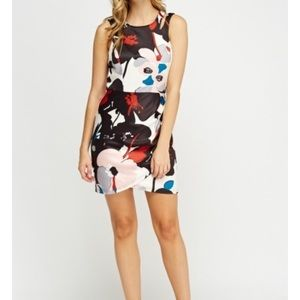 Dresses & Skirts - Brand new wrap floral print dress. Size small