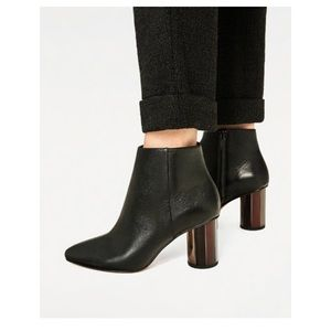 Black leather ankle heel booties contrast heel