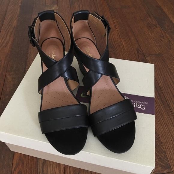bbe1b4ae747f Clarks Acina Newport Black Leather Wedge Sandal. M 5972529e620ff7af860302c3