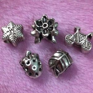 Jewelry - Flower, star, strawberry, leaf charm set