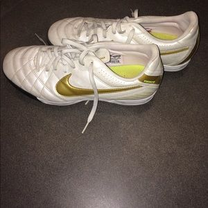 White and gold Nike indoor cleats