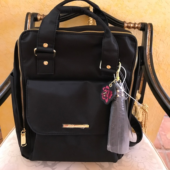 3563e714a334 Steve Madden Black and Gold Backpack