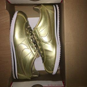 Gold/white Nike Cortez 6Y 8 women