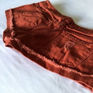 Ripped Red Denim Shorts